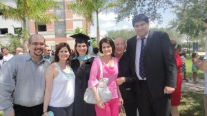 Maria and Raul with her family at her master's graduation ceremony