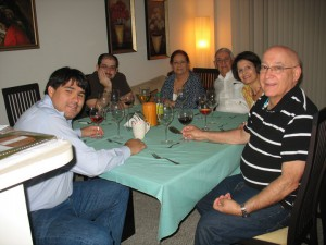 Raul with Maria's family at a Thanksgiving dinner